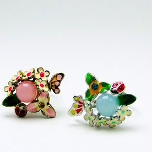 Two adjustable whimsical rings floral motif